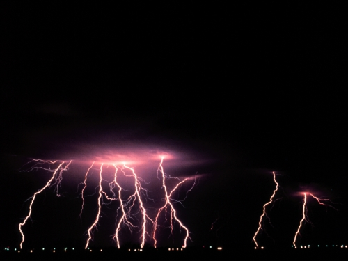 Lightning strikes during a nighttime thunderstorm.