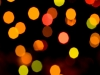 Colorful holiday lights out of focus.